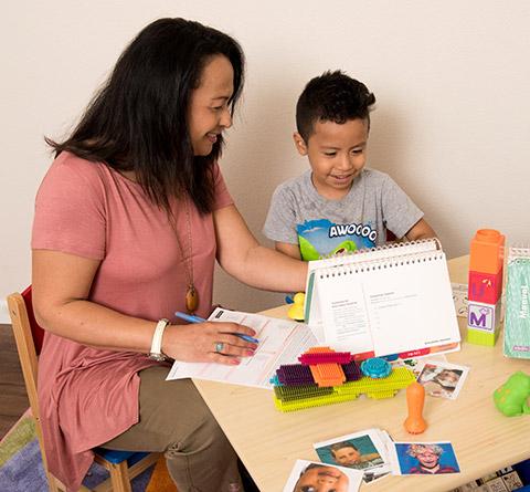 Woman Teaching Child