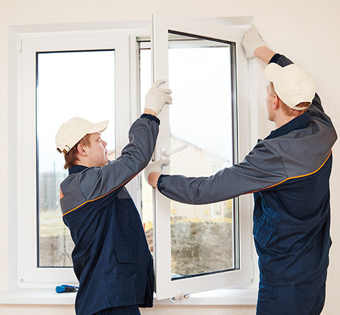 Two Men Weatherizing a Window